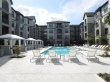 Resort Style Pool with Sun shelf and Cabanas